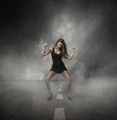 strong girl in the middle of a road