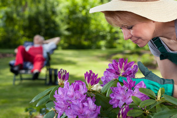Female gardener caring about flowers