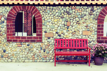 Red bench with flowers