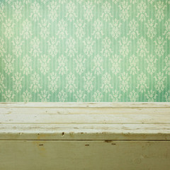 Retro classical wallpaper and wooden table