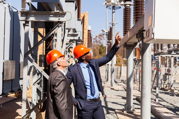 managers inspecting electricity power plant
