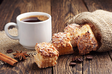 Coffee and sweet puff cookies with nuts