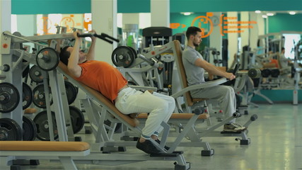 two men doing exercise for the chest muscles