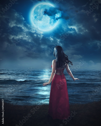 Woman and blue moon. - 69166457