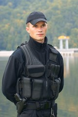 Security guard in uniform and armed
