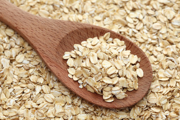 Rolled oats in a wooden spoon