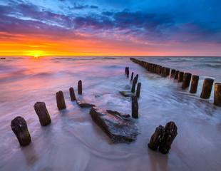 fototapeta zachód słońca na plaży Morza Bałtyckiego