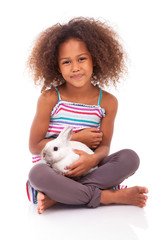 African Asian girl holding a rabbit