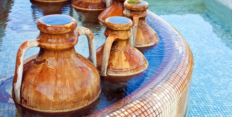 fountain with amphoras in a spa