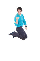 Young successful man jumping out of joy expressing happiness