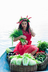 beautiful woman with vegetables and green onions in hands