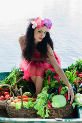 sexy woman in a boat with vegetables