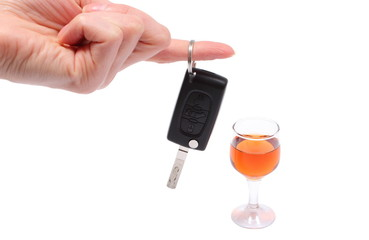 Hand of woman with key car and glass of wine