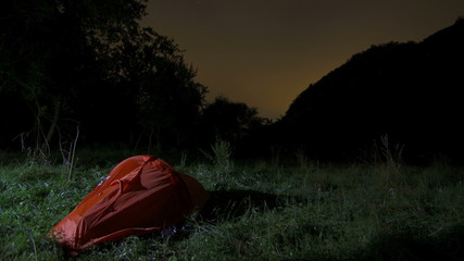 Wilderness Camping tent in forest meadow  night Transylvania