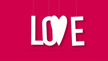 Dangling love word over bright pink background