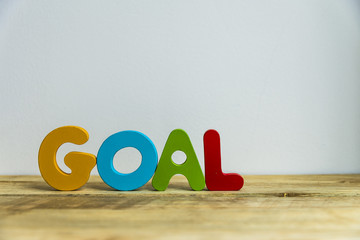 Colorful wooden word Goal with white background7