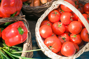 basket with different vegetables, a basket of tomatoes
