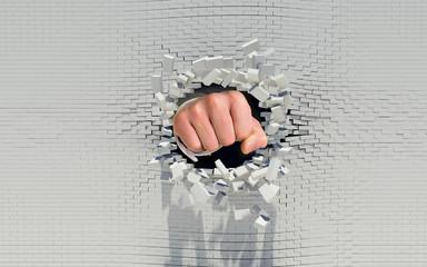 Fist punching through a brick wall