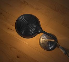 Metal lamp standing on a floor