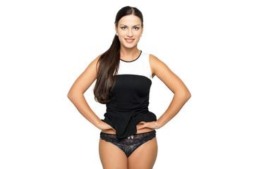Sexy woman in black underwear on a dark wall