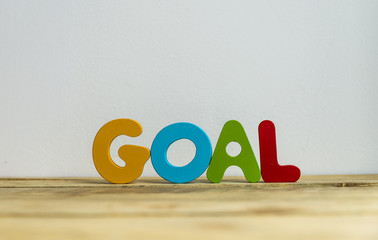 Colorful wooden word Goal with white background