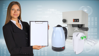 Businesswoman with coffee machine, kettle and blender