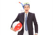 Businessman with a diving equipment and a beach ball