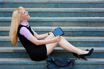 blonde business  woman  with tablet