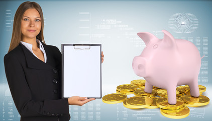 Businesswoman hold paper holder. Piggy bank with gold coins