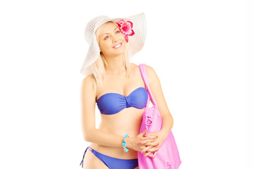 Attractive blond woman in swimsuit looking at camera