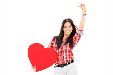 Attractive woman holding a big red heart