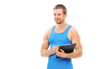 Fitness coach holding a clipboard