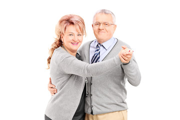 Mature couple dancing tango