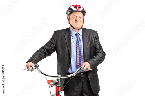 Mature businessperson holding a bicycle