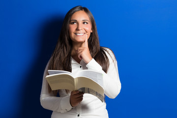 beautiful female student with book
