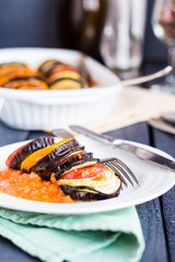 vegetable ratatouille on a plate with sauce, vertically