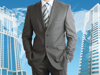 Businessman with world map and skyscrapers