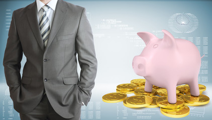 Businessman with piggy bank and gold coins