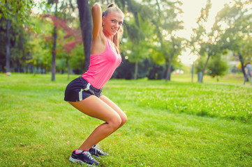 fit and muscular woman in park, doing squats and running at park