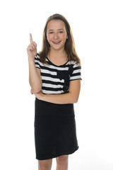 Pretty young girl pointing above her head