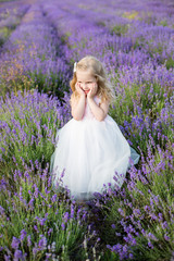Smiling toddler girl in lavender