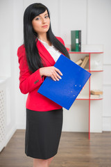 Young pretty business woman in red jacket