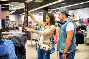 Portrait of shopping couple that choosing dress together