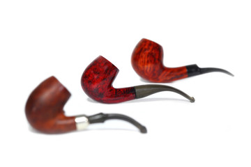 Tobacco pipe on the white background