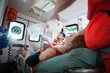 canvas print picture - Injured woman needs oxygen in ambulance