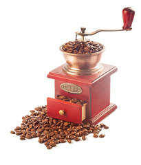 Coffee grinder with coffee beans isolated on white background