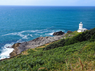 Scenic lighthouse at Cornwall coastline