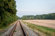 train tracks near meadow