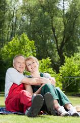Happy married couple in garden