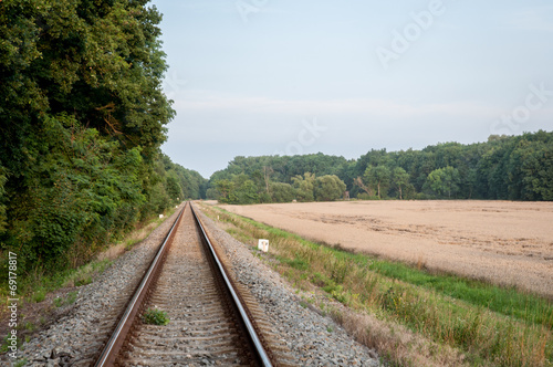 train tracks near meadow
